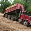 Globe/Roger Nomer<br /> A truck dump gravel at Shady Beach Campground on Tuesday afternoon.
