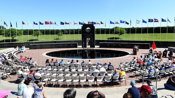 Guests gather to remember those we have lost during Memorial Day ceremonies on Monday at the  Pittsburg State University Veterans Memorial.<br /> Globe | Laurie Sisk