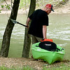 Aaron Patrum, of Cullman, Ala., searches for extended family member, 12-year-old Brooke Robinson, who was swept away in Shoal Creek on Monday. Patrum and others drove all night from Alabama to help find the missing girl. <br /> Globe  Laurie Sisk