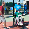 "Eight-year-old Amaeraey Hillmorgan swings away as volunteer Michael Landis and ""Buddy"" Wyatt Satterlee, 13, look on during Miracle League action on Saturday at the Will Norton Field of Dreams. Satterlee is a member of North Middle School's Peer Buddies program.<br /> Globe 