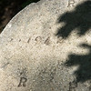 Globe/Roger Nomer<br /> The build date of a picnic table is stamped on the concrete chair at Walter Woods Conservation Area.
