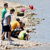 Loved ones gather Wednesday on the banks of Shoal Creek, where 12-year-old Brooke Robinson is still missing after a Monday afternoon floating accident.<br /> Globe | Laurie Sisk