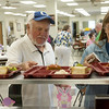 Globe/Roger Nomer<br /> Glen Borland and Sandy Porter get their lunch on Wednesday at the Carthage Senior Center.