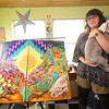 "Carthage artist Martha Goldman and her dog, ""Bowie"" stand beside one of Goldman's works last March. <br /> Globe 