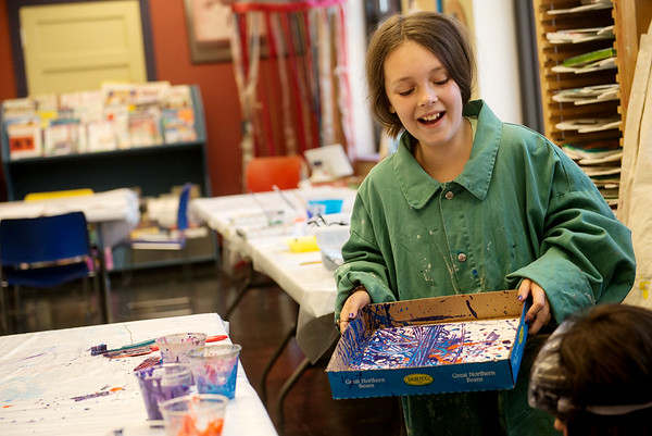 Globe/Roger Nomer<br /> Rayna Wiebelhaus, 8, uses a marble to make her action painting on Tuesday at Spiva Center for the Arts.