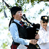 "Dorothy May, St. Andrews Pipes and Drums, plays ""Amazing Grace"" on the bagpipes during Memorial Day ceremonies on Monday at the  Pittsburg State University Veterans Memorial.<br /> Globe 