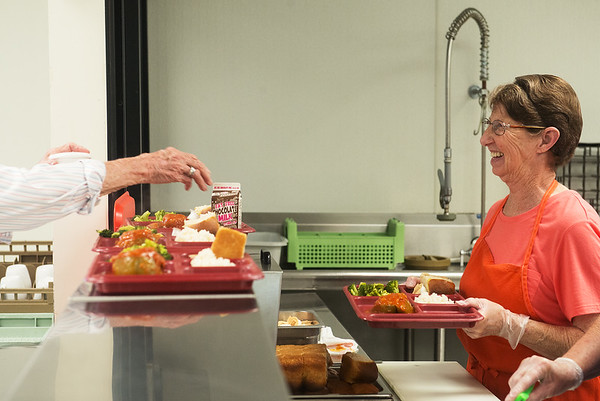 Globe/Roger Nomer <br /> Nina Maggard serves lunch on Wednesday at the Carthage Senior Center.