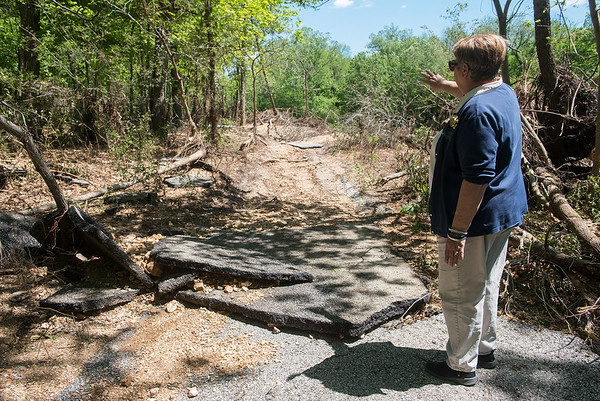 Globe/Roger Nomer<br /> Donna Whitehead, center director, talks about a washed out trail at Wildcat Glades on Friday.