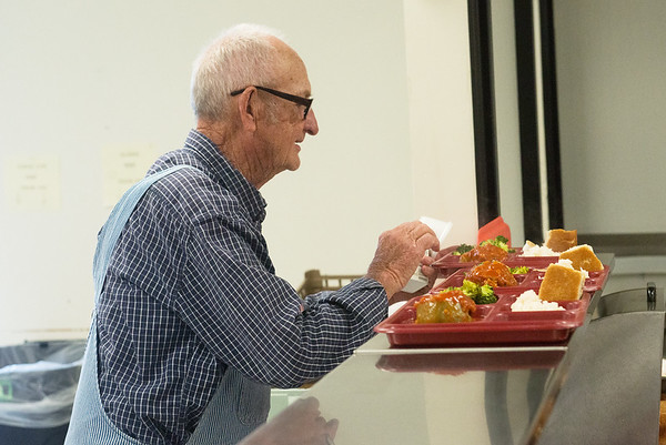 Globe/Roger Nomer<br /> Paul Parnell gets lunch on Wednesday at the Carthage Senior Center.