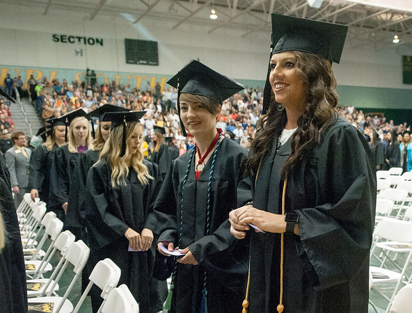 Melissa Gratton, of Webb City, smiles as she stands in front of her seat during the processional during graduation ceremonies on Saturday at Missouri Southern.<br /> Globe | Laurie Sisk