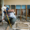 Globe/Roger Nomer<br /> Mandy Goodlin, Ft. Meyer, Fla., tears down drywall in a house in Neosho as she volunteers with Team Rubicon on Wednesday afternoon.