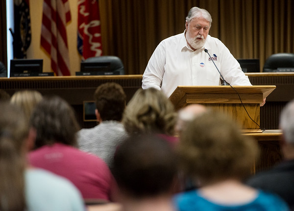 Globe/Roger Nomer<br /> Joplin Councilman Gary Shaw leads a prayer for government during Thursday's National Day of Prayer at Joplin City Hall.