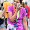 Karen Haynes cools off after finishing her second-ever half marathon on Saturday at the Joplin Memorial Marathon.<br /> Globe | Laurie Sisk