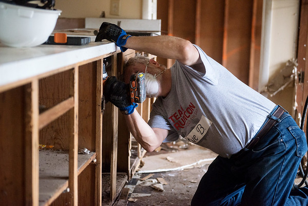 Globe/Roger Nomer<br /> Steve Berry, Brookfield, N.H., takes apart a cabinet on Wednesday at a house in Neosho as he volunteers with Team Rubicon.
