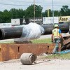 A Missouri American Water crew installs part of a project that includes l3,500 feet of 24-inch ductile iron water pipe on 20th Street near Joplin High School on Tuesday. This week the company has joined with the American Water Works Association to recognize National Drinking Water Week. Their goal is to educate customers about the role water plays in public health, fire protection, economic vitality and quality of life. <br /> Globe | Laurie Sisk