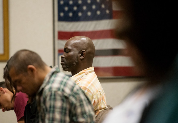 Globe/Roger Nomer<br /> Marcell Davis, Jr., Joplin, prays during Thursday's National Day of Prayer at Joplin City Hall.