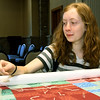 Fifteen-year-old Emma Webb, of Webb City, learns from veteran quilters as they construct a quilt Webb is making for her parents on Thursday at the First United Methodict Church in Carthage.<br /> Globe | Laurie Sisk