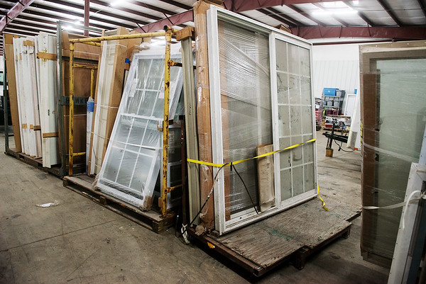Globe/Roger Nomer<br /> Recent donations to the Habitat for Humanity Restore include windows.