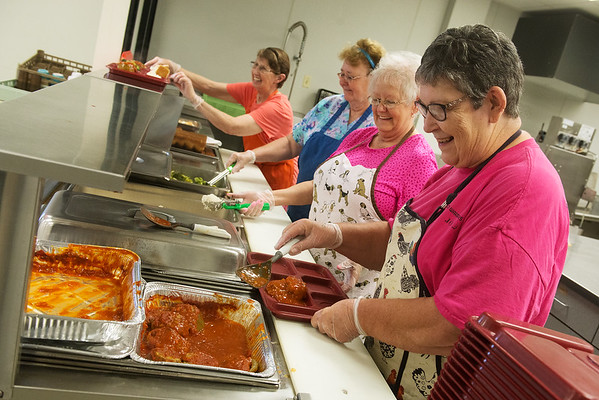 Globe/Roger Nomer<br /> (from left) Nina Maggard, Pat Cardwell, Dixie Clayton and Lenora Darland serve lunch on Wednesday at the Carthage Senior Center.