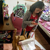Globe/Roger Nomer<br /> Gabby Gomez, 10, decides what to keep from her water-damaged room on Monday in Neosho.