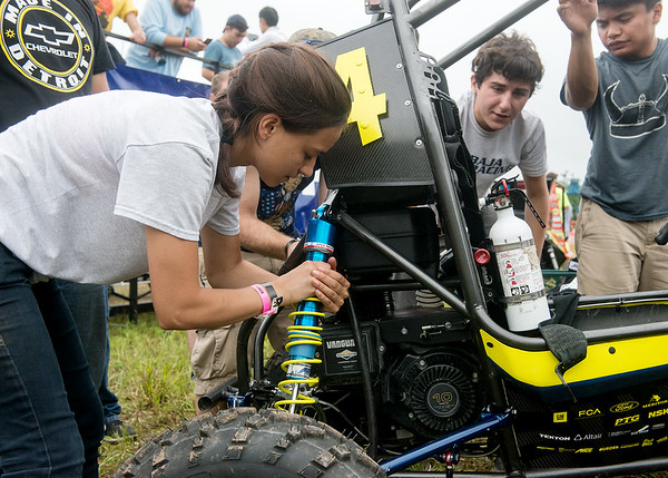 Globe/Roger Nomer<br /> Lizzy Miranda, from the University of Michigan, adjusts the shocks on her team's baja car on Saturaday during the Baja SAE Kansas event at Pittsburg State.