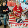 Globe/Roger Nomer<br /> Mick and Jan Waldie, of VFW Post #322, offer veteran-made poppy flowers on Thursday at the Webb City Farmers Market. The flowers were free, but donations were being accepted for local veterans. Poppies will be available again on Saturday at the market and other locations throughout the weekend.