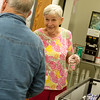 Globe/Roger Nomer<br /> Barbara Lane serves milk on Wednesday at the Carthage Senior Center.