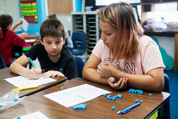 Globe/Roger Nomer<br /> Kolter Zaerr and Lili Munoz, fifth grade, work on a math problem on Tuesday at Jasper Elementary.