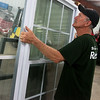 Globe/Roger Nomer<br /> Roy Farley, volunteer, moves windows from a recent donation to the Habitat for Humanity Restore on Friday.