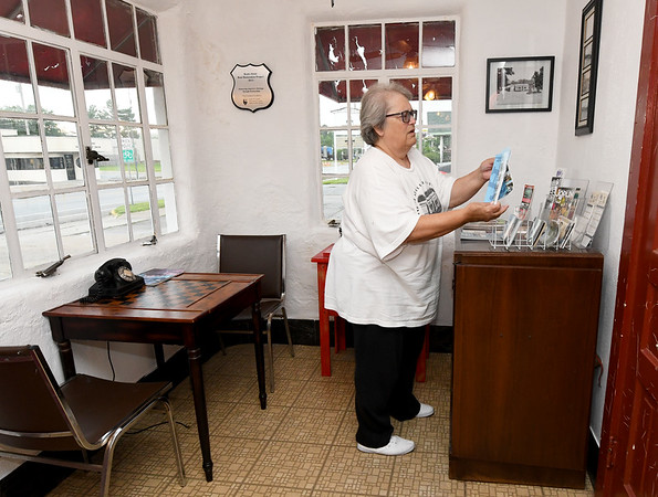 Boots Court owner Deb Harvey organizes brochures in the lobby of the historic hotel in Carthage on Wednesday. The motel is a longstanding attraction along Route 66.<br /> Globe | Laurie Sisk