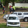 Emergency workers search for 12-year-old Brooke Robinson, who was swept away in Shoal Creek on Monday.<br /> Globe  Laurie Sisk