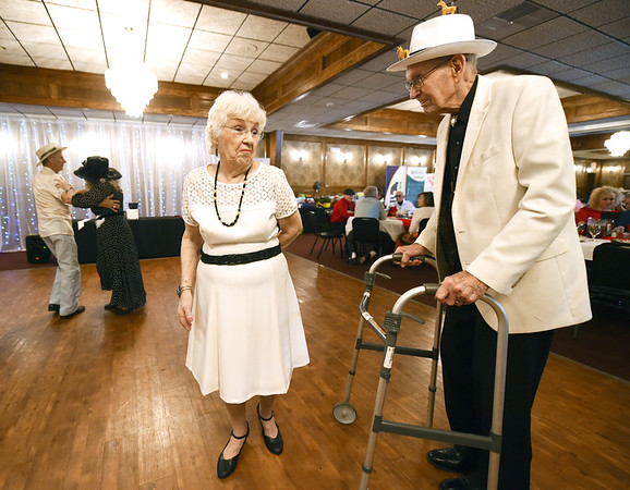 Joan McMullen Thompson and her husband Tommy Thompson share a dance during the Area Agency on Agency's Senior Prom on Wednesday at The Butcher's Block. The couple met at the dance five years ago and have been married for four years.<br /> Globe | Laurie Sisk