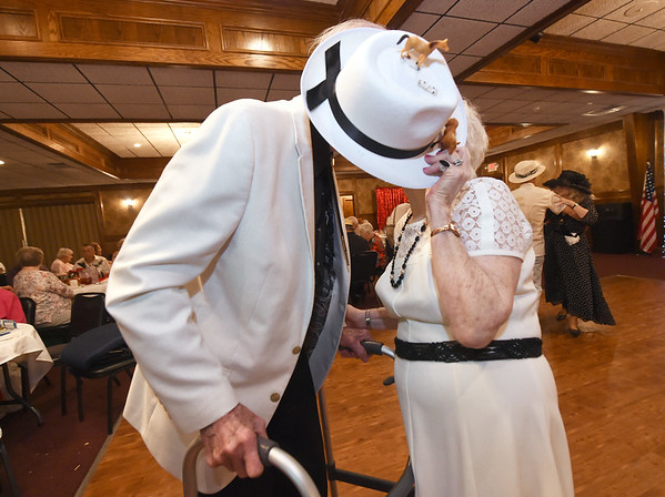 Joan McMullen Thompson sneaks a smooch with her husband Tommy Thompson during the Area Agency on Agency's Senior Prom on Wednesday at The Butcher's Block. The couple met at the dance five years ago and have been married for four years.<br /> Globe | Laurie Sisk