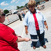 Brenda Ayers, Riverton, left, talks with Athena McColm following a dedication on May 18 of the Columbus Veterans Memorial.<br /> Globe | Roger Nomer