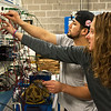 Emilee West works with Carlos Henriquez on a motor control trainer on Tuesday at the Joplin Advanced Training Center.<br /> Globe | Roger Nomer