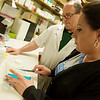 Tim Mitchell, pharmacist and owner, and Dwon Taylor-Pina, technician, work with opiods on Friday at at Mitchell's Downtown Drug Store in Neosho.<br /> Globe | Roger Nomer