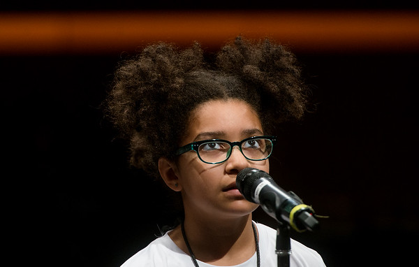 Elainah Omwango, a fourth grader from Royal Heights Elementary in Joplin, thinks before spelling a word during Monday's 2018 Joplin Globe Spelling Bee at Thomas Jefferson Independent Day School.<br /> Globe | Roger Nomer