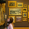 Annabel Brown, 9, Dallas, checks out the new salon-style display in the Early American Galleries at the Crystal Bridges Museum of American Art on Thursday.<br /> Globe | Roger Nomer