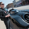 David Hickmott, marketing director, talks about a replica Batmobile to be featured at the Decades of Wheels museum in downtown Baxter Springs on Wednesday.<br /> Globe | Roger Nomer