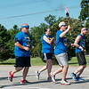 Cail Tingle, 16, carries the torch for the Webb City leg of the 2018 Law Enforcement Torch Run on Tuesday.<br /> Globe | Roger Nomer