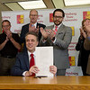 Kansas Gov. Jeff Colyer signs budget legislation during a visit to Pittsburg State on Tuesday at the Axe Library.<br /> Globe | Roger Nomer