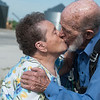 After parachuting for his 90th birthday, Jim Oglesby gets a kiss from his wife Mary upon landing on May 19 in Miller. The couple has been married for 67 years.<br /> Globe | Roger Nomer