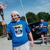 Cail Tingle, 16, waits for the start of the Webb City leg of the 2018 Law Enforcement Torch Run on Tuesday morning.<br /> Globe | Roger Nomer