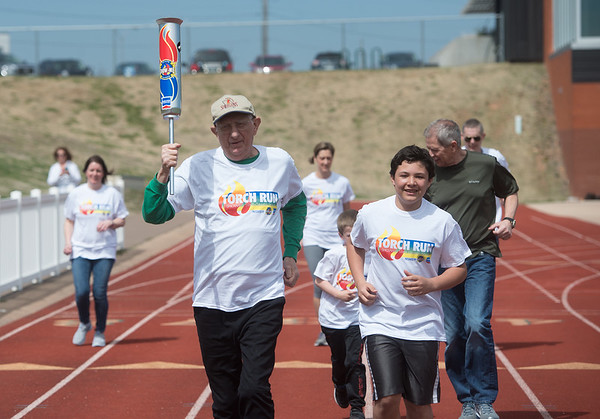 Dave McCoy, Carthage, leads off the Shelter Insurance Torch Run on Thursday at Missouri Southern to promote the Show-Me State Games happening later this year in Columbia, Mo. McCoy is a past participant in the games, which offer Olympic-style events for all ages and ability levels.<br /> Globe | Roger Nomer