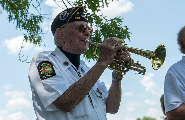 Bruce Benson plays Taps for a fallen WWI soldier on Monday at Carterville Cemetery.<br /> Globe | Roger Nomer