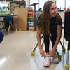 Jadyn LaFerla, a fifth grader at St. Mary's Elementary, reacts to having marbles in her shoes, which is meant to simulate having autism during a presentation on Monday.<br /> Globe | Roger Nomer