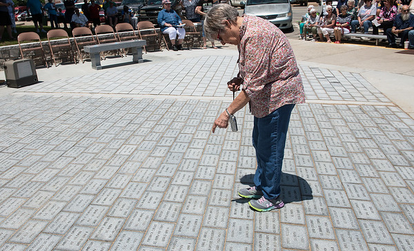 Donna Hollern, Columbus, looks for her husband's paver at the Columbus Veterans Memorial on May 18. Eldon Hollern was an Air Force veteran.<br /> Globe | Roger Nomer