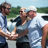Simon Buchel talks with Debbie Nichols and Stephen Herman, from the Joplin Cycling Enthusiasts, after visiting the ghost bike dedicated to his father Heinz-Gerd and Harry Jung in Galena on Friday.<br /> Globe | Roger Nomer
