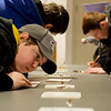Noah Wyatt, a freshman at Mt. Vernon High School, leans in to identify an insect during competition at Aggie Day at Crowder College on Thursday.<br /> Globe | Roger Nomer