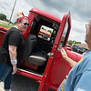 Brad Hill, Pittsburg, shows his 1958 Willy's Pickup to Whitney Buckle, adminstrator of the Pittsburg Care and Rehabilitation Center, during the Center's Fabulous Fifties Function on Wednesday.<br /> Globe | Roger Nomer